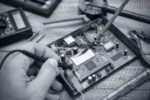 Electronics repair service. Technological background.